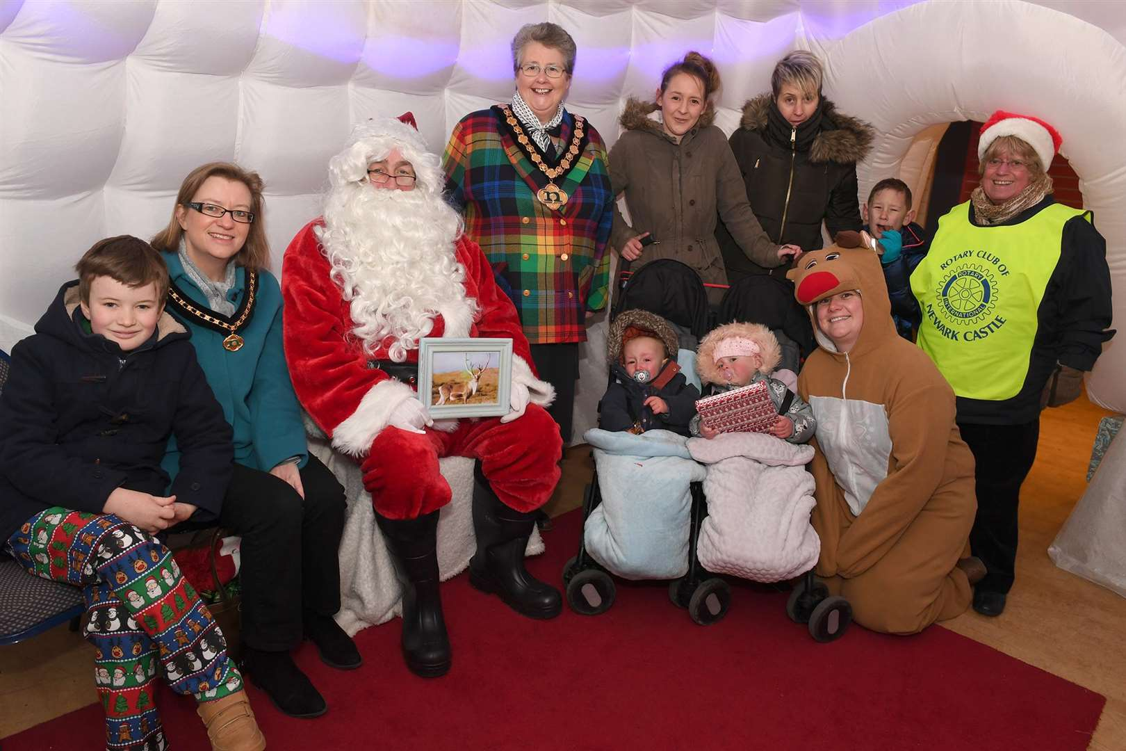 The chairman of NottinghamshireCounty Council Mrs Sue Saddington at Newark Castle Rotary Club Santa's Grotto. Left to right her grandson William Saddington 10, daughter Caroline Saddington, Father Christmas, Mrs Saddington, Miss Courtney Nixon, Miss Rachel Nixon, Kaylum Weir 6, and club president Glen Foreman. Front, left to right,Bentley Weir, De-Anna Weir and Emma James. (6034861)