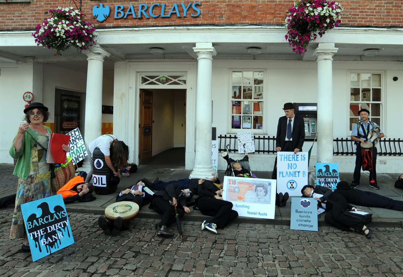 Rebels stage 'die-in' outside Barclays Bank