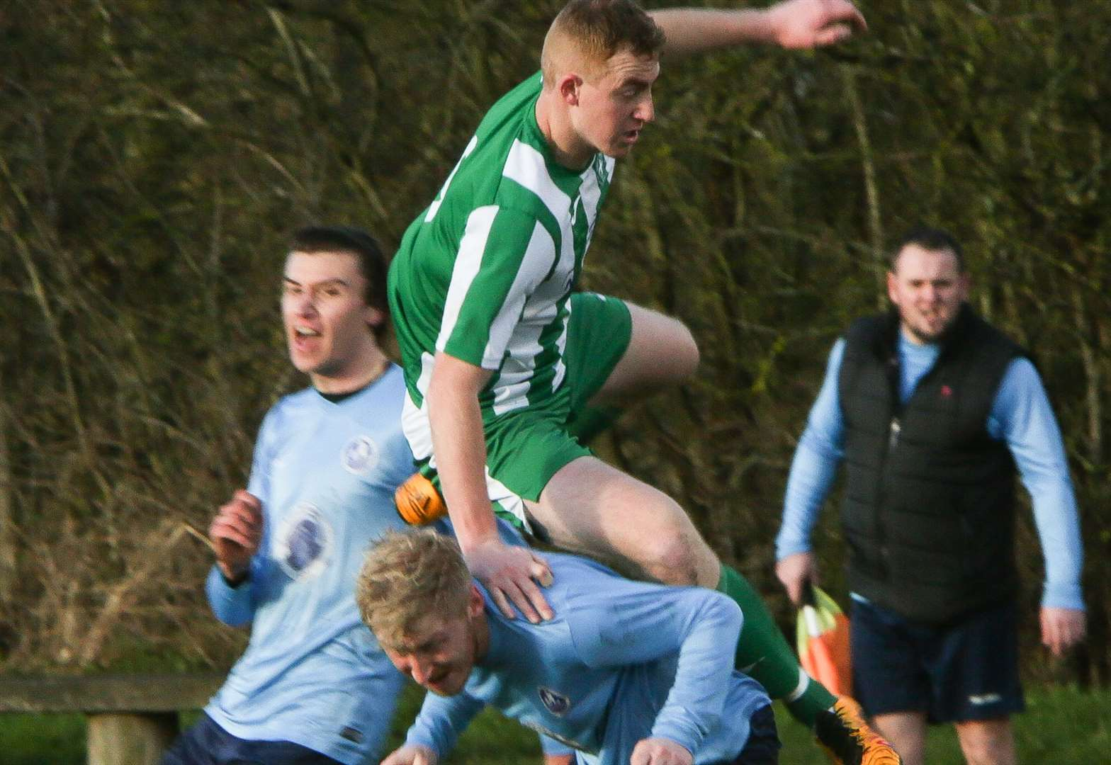 Town toppled by Trinity as cup holders bow out