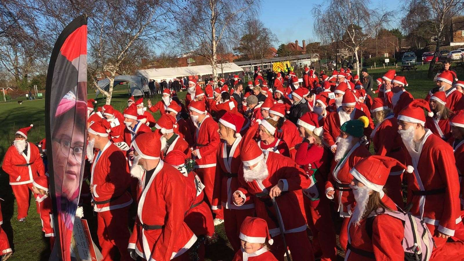 A HOST of Father Christmases pass the start line on a previous Santa run for Reach Learning Disability.