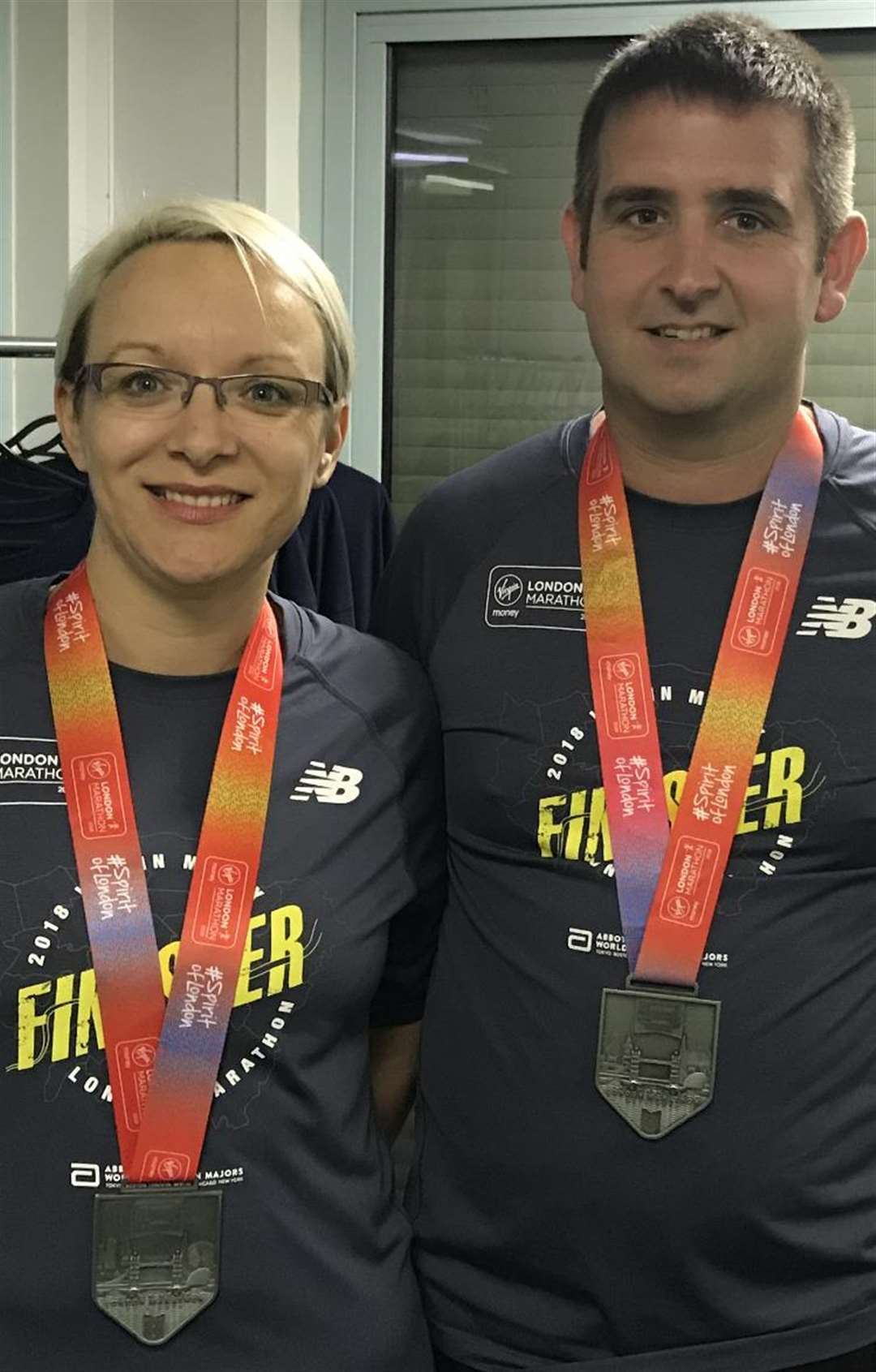 Breeze and Andy Rowlands, of Notfast, with their London Marathon medals