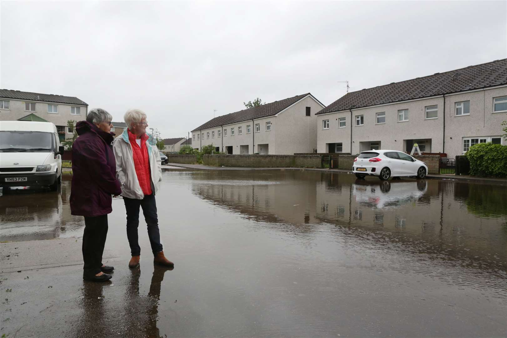 Cllr Irene Brown and Cllr Gill Dawn at the site of severe flooding on Lincoln Court, Newark. 110619TV2-1. (12162131)