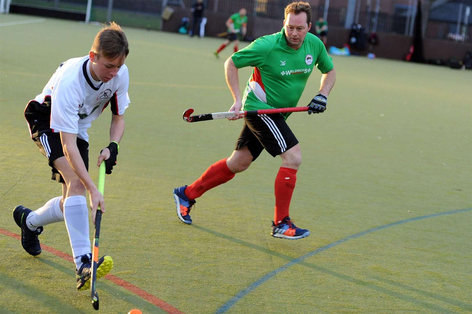 BEN BROWN (green) hit Newark's second in the men's 1sts 2-0 win over Mansfield.