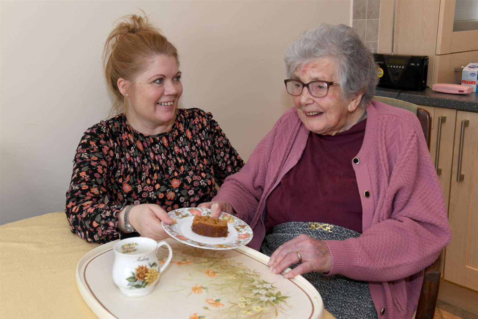 Mrs Audrey Lloyd, 93, of Collingham, with her personal assistant Kirsty Giles. 030220DD2-4