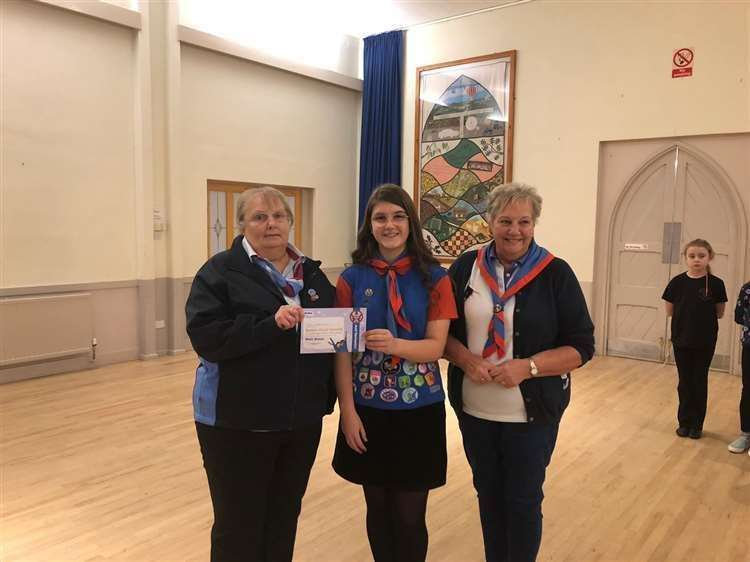 Pat with Darcy Fjelo-Jarvis of 1st Long Bennington Guides and Necia Redfern, Lincolnshire South county adviser.