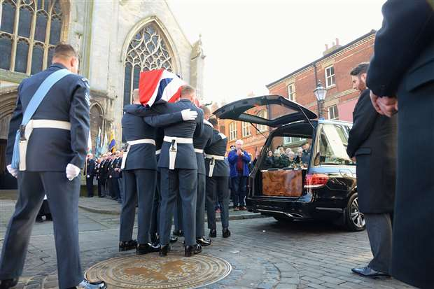 The coffin is carried from the hearse. (28526894)