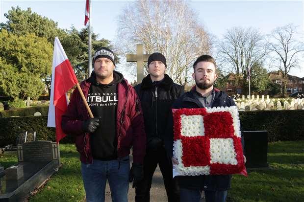 Prezemyslaw Makowski, Mirek Przetacznik and Daniel               Wozniak pay their respects. 060220TV-13
