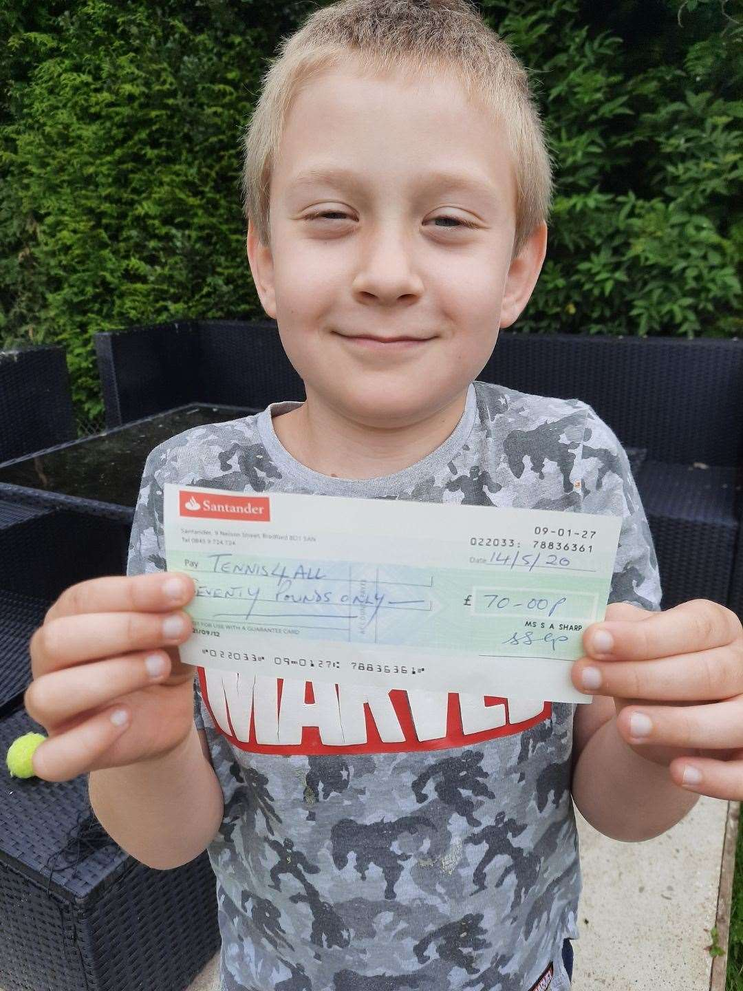 OLIVER SPENCER, nine, has raised money for Caunton Tennis Club ahead of its reopening.