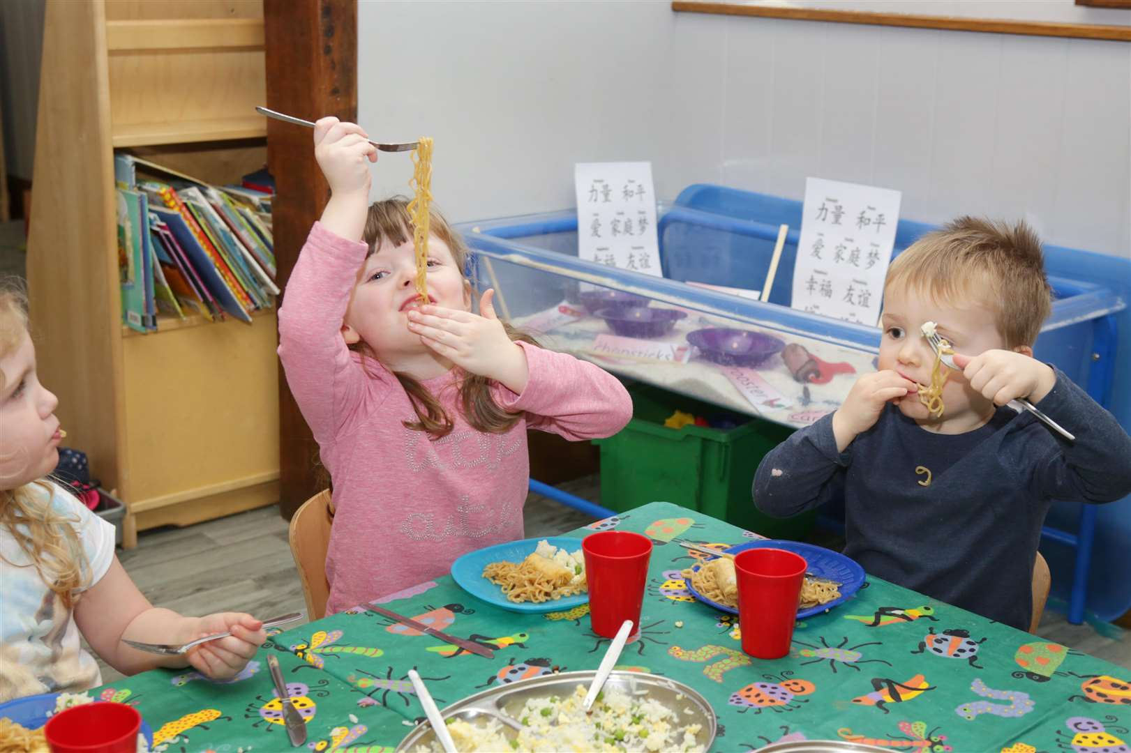 Jessica Warwick-Read, 4 and Jack Taylor, 3, tuck into a chinese meal as part of their Chinese New Year celebrations at Serendipity Day Nursery, Balderton.. (6993783)