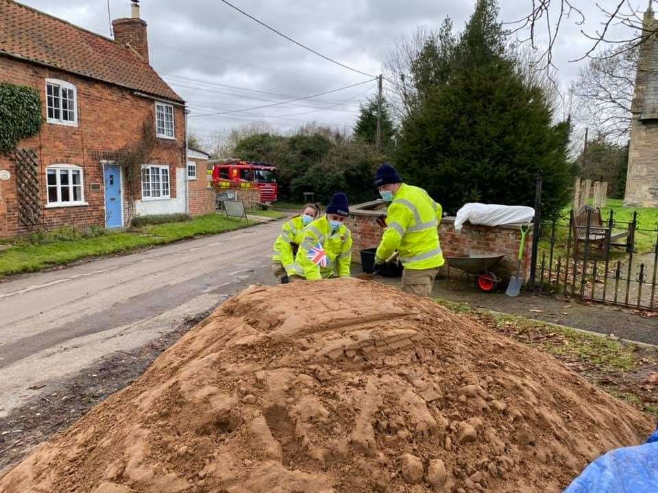 Collingham firefighters fill sandbags in flood-threatened Girton. (44194217)