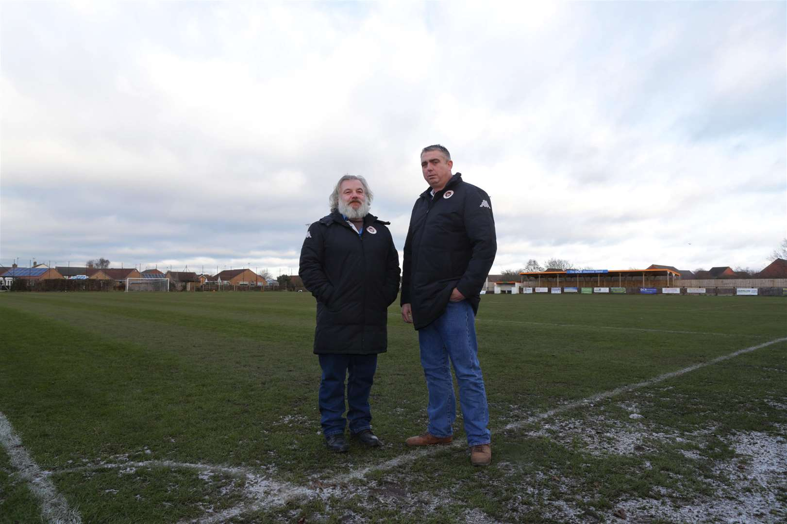 POSTPONED: Newark Flowserve's chairman Gary Clarke (left) and Wayne Spindley stand on the frozen Lowfields pitch.