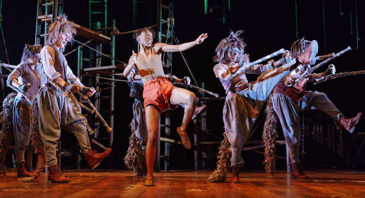 Keziah Joseph as Mowgli and the company of The Jungle Book. Photograph: Manuel Harlan