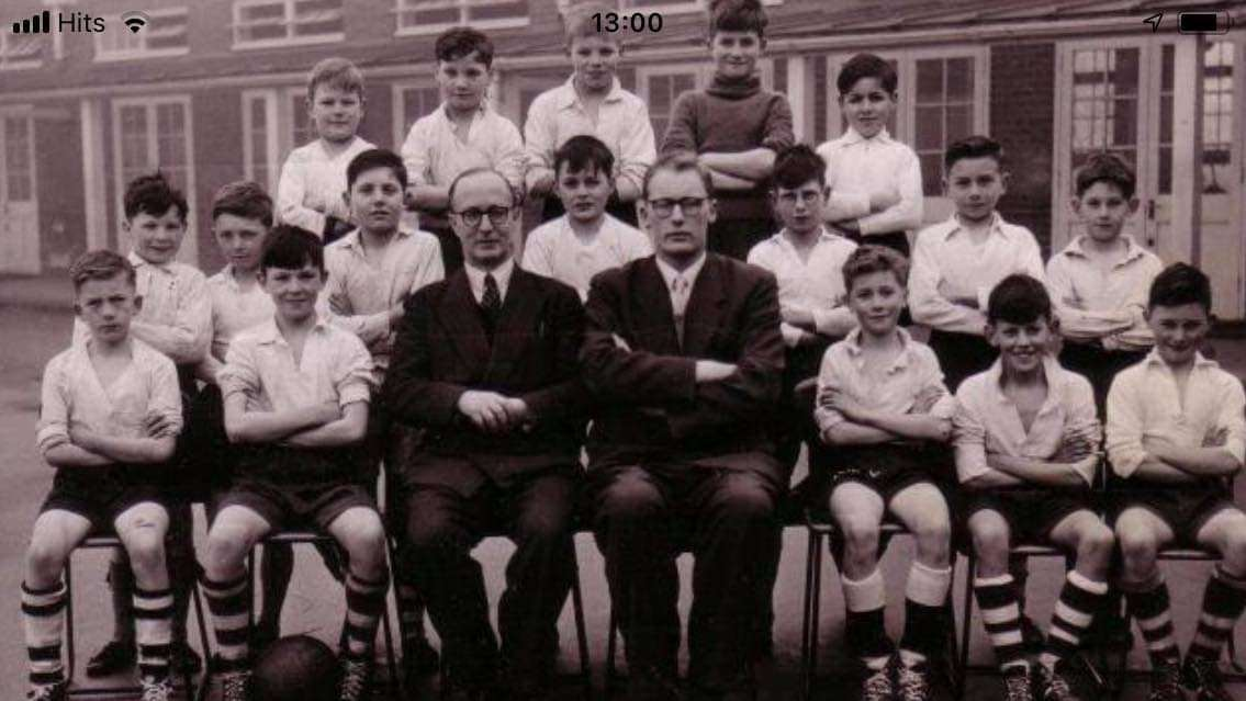 Alvyn Cooling is pictured in a school photograph on the second row, first from the left.