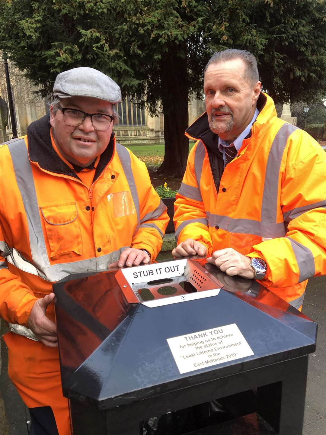 Waste management operative Robert Sproates (left) with district council business manager – waste and transport Andy Kirk at one of the town's litter bins.