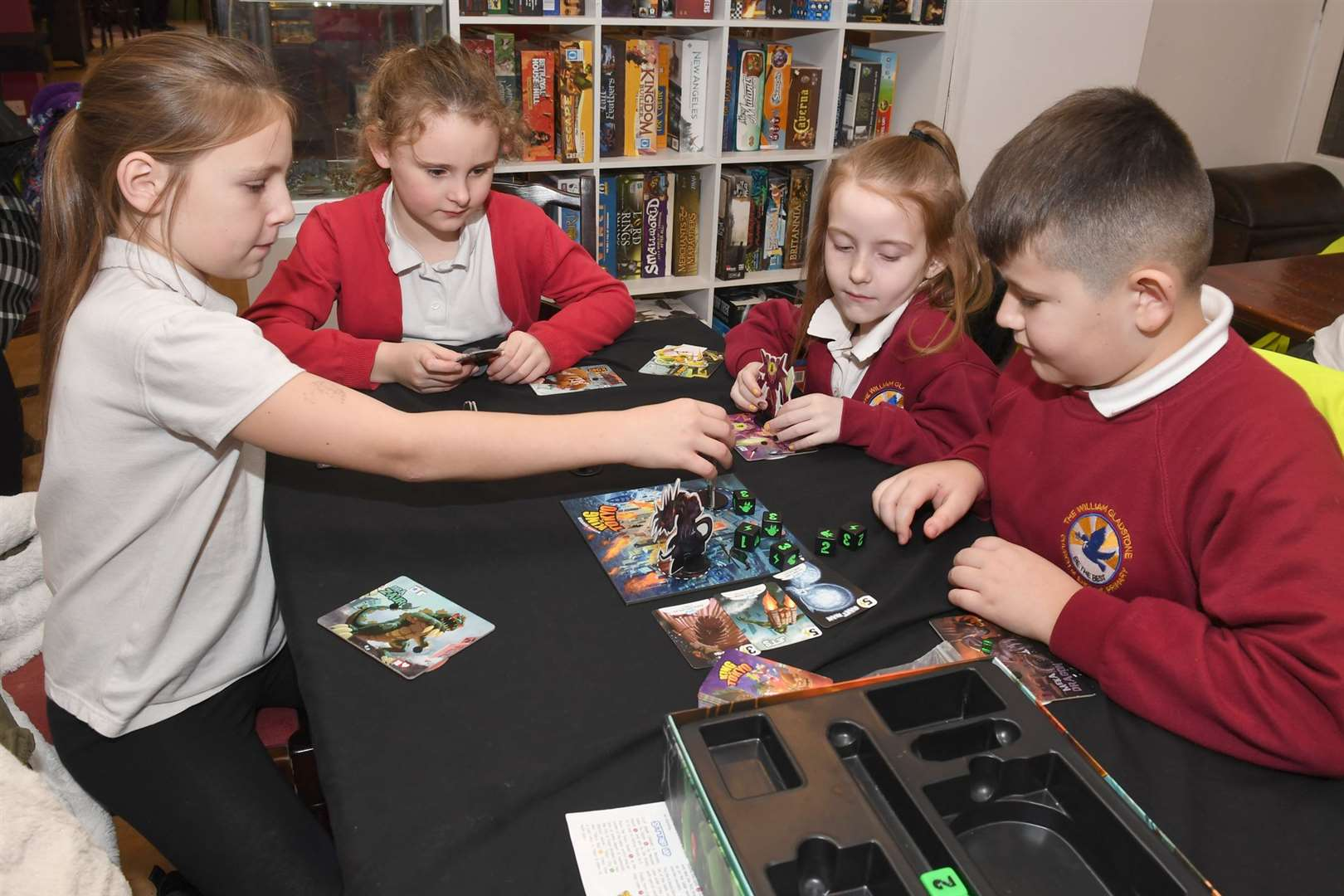 William Gladstone pupils at Xcape board game cafe..L-R Brodie White 10, Lacie Sharp 7, Lacey Summerfield 6, Coby Rolfe 9. 111219DD9-4. (24081009)