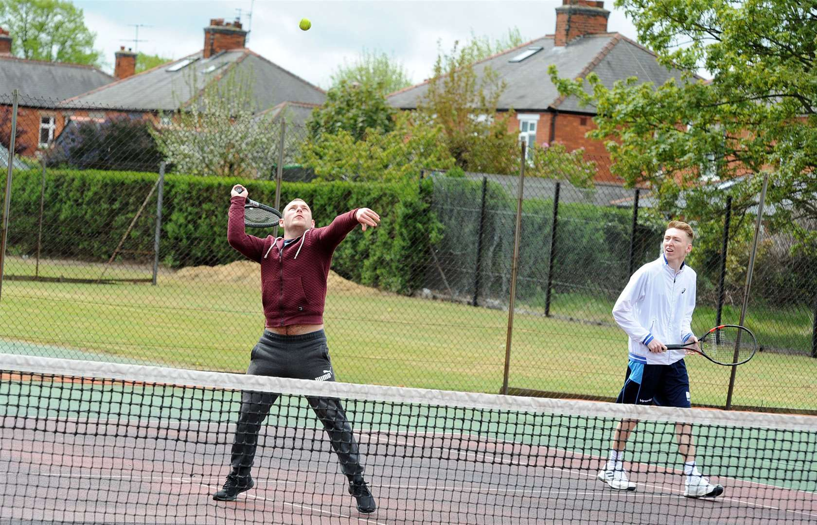 Newark Tennis Club held a fundraising day along with their open season tournament .Pictured is John Jessop left and Ashley Hallam in action. (9325125)