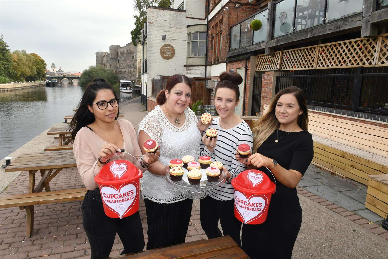 Water's Edge, Newark, are raising money for a defibrillator after doing a first aid course, starting the fundraising with a cupcake sale. L-R Marta Carmo (front of house), Donna Boxall (general manager), Leigh Graham (cupcake maker), Eloise Shuckburgh (events manager). (4686119)