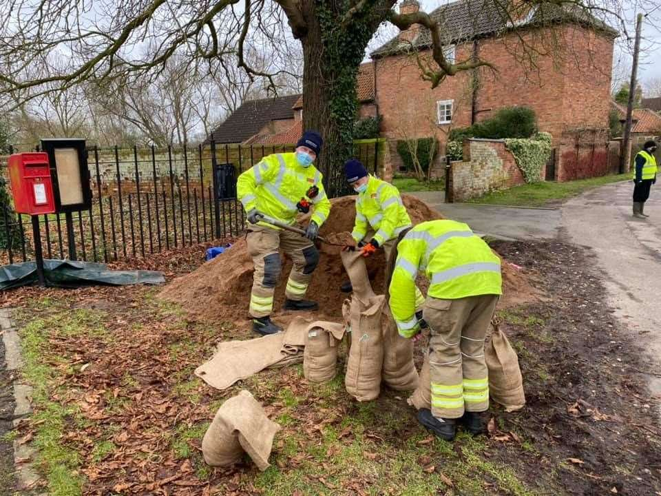 Collingham firefighters fill sandbags in flood-threatened Girton. (44194219)