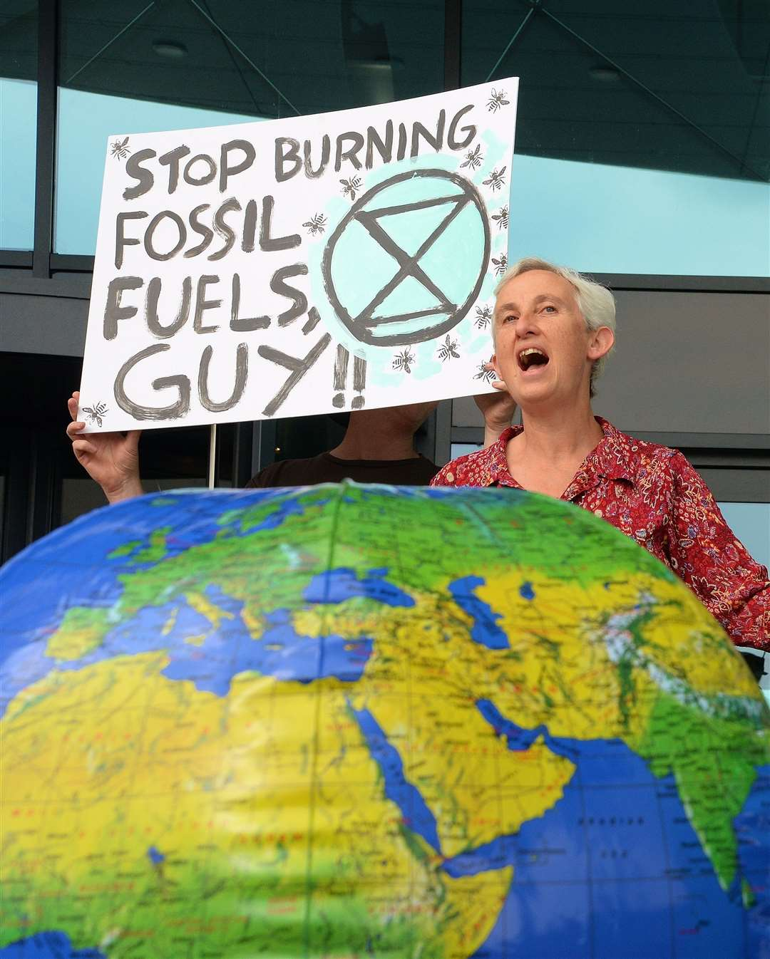 PROTESTORS outside Castle House for the climate change motion debate. Kate Martin, from Southwell. 160719DC1-3 (13924226)