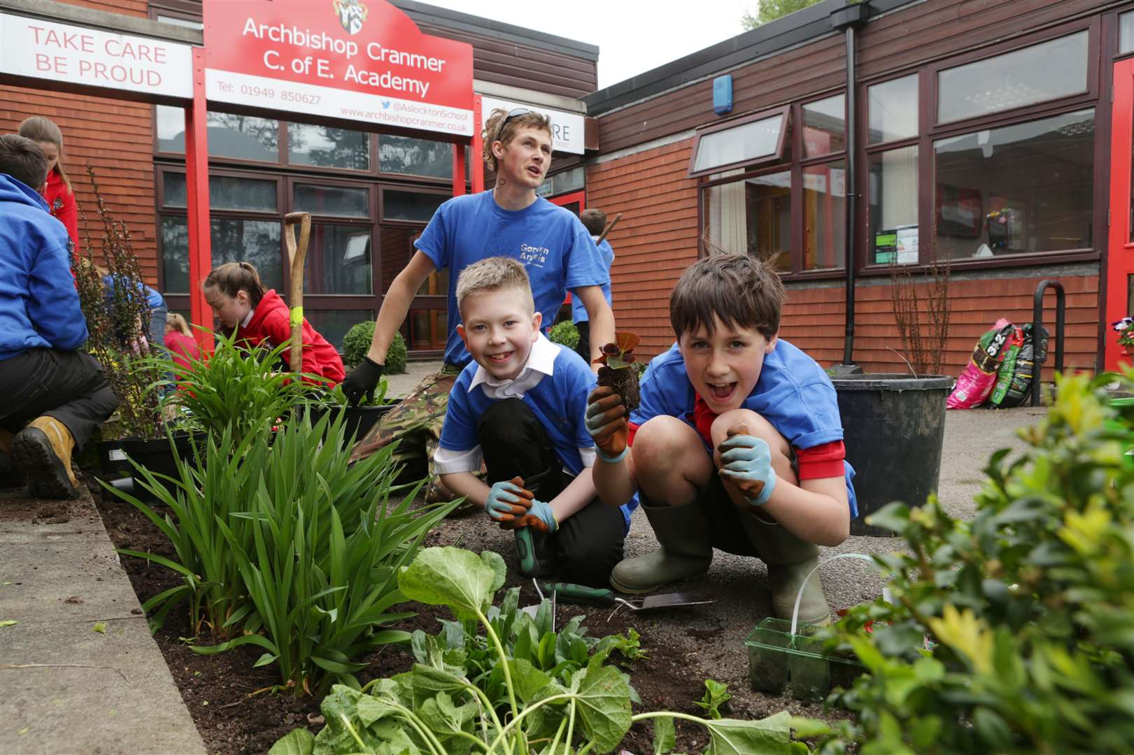 Archbishop Cramner pupils Benjamin Barr, 10 and Daniel Ivemey, 9, spruce up the entrance to their school. 260419TV2-3. (9340655)