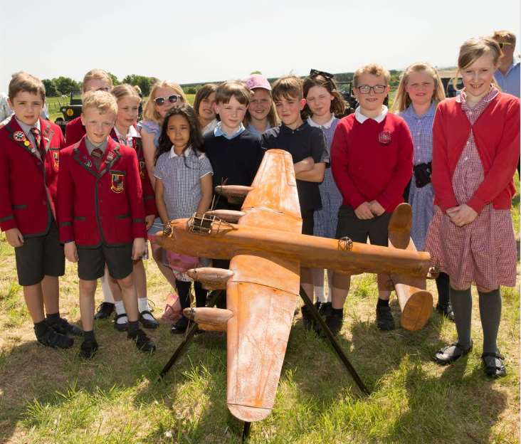 Pupils from Highfields School, Newark, Brant Broughton Primary School, and John Blow Primary School, Collingham, with a model of the Lancaster sculpture at the site where a full-sized version will be erected.