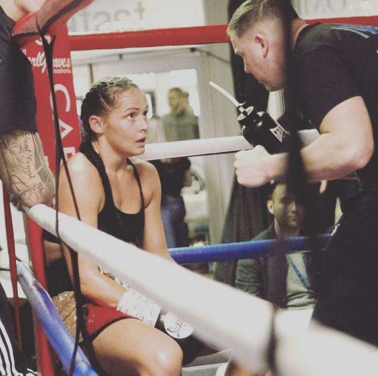 Nina Bradley and Carl Greaves discuss fight tactics between the rounds. Credit: nina_bradley_30 on Instagram.