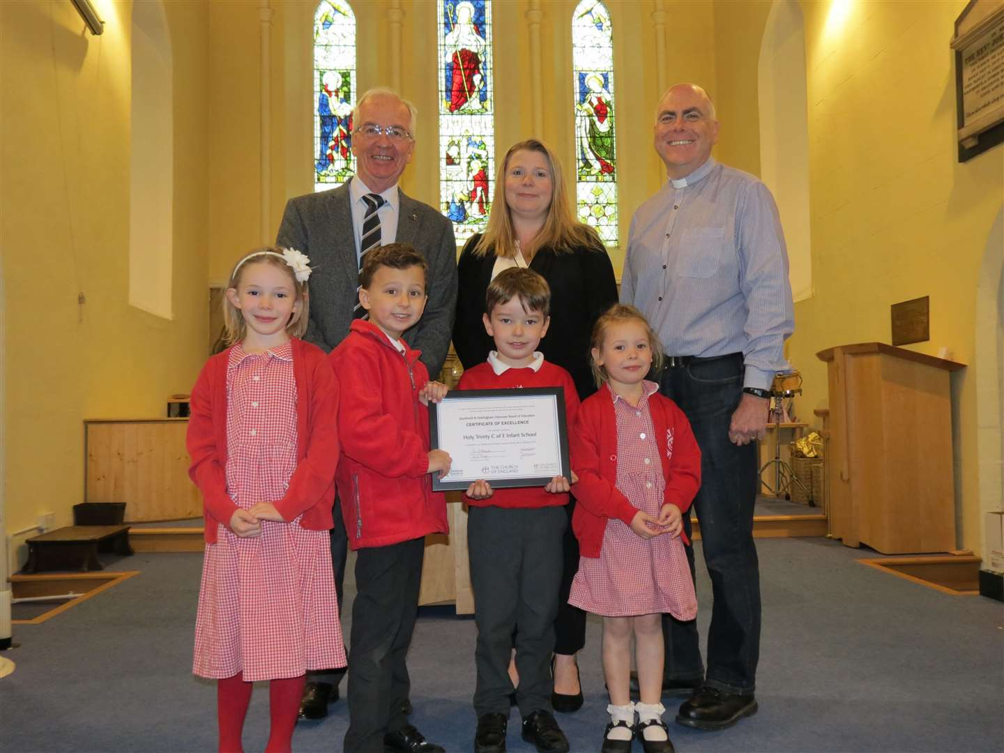 Tony Derby, executive headteacher Marie Thompson and Reverend Andrew Porter from Holy Trinity Church, Southwell with pupils Isabelle Jardine, Harry Milligan, Samuel Thompson and Millie Everington.