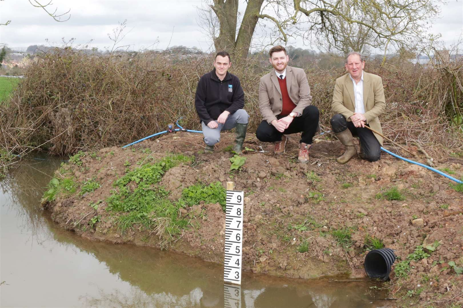 Flood Risk Reduction, Southwell..L-R Josh Wells, Project Officer from Trent Rivers Trust, Councillor Phil Rostance, Vice Chairman for Communities and Place Committee, and land owner Neil Malik of Smithfield Park Livery Stables, Southwell beside a flood management pond on Neil Malik's land.. (7891755)