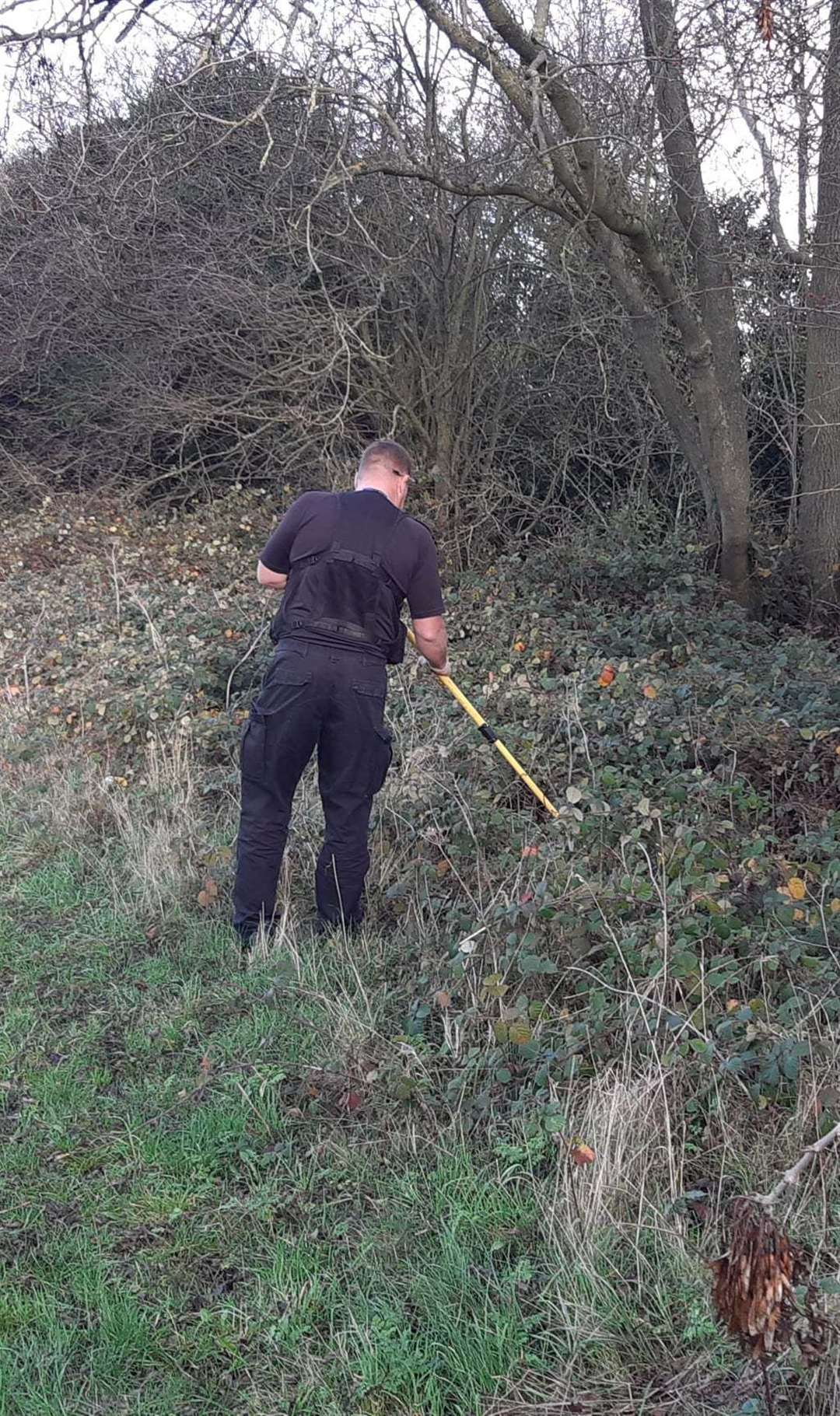 An officer conducting the weapon sweep. (43155470)