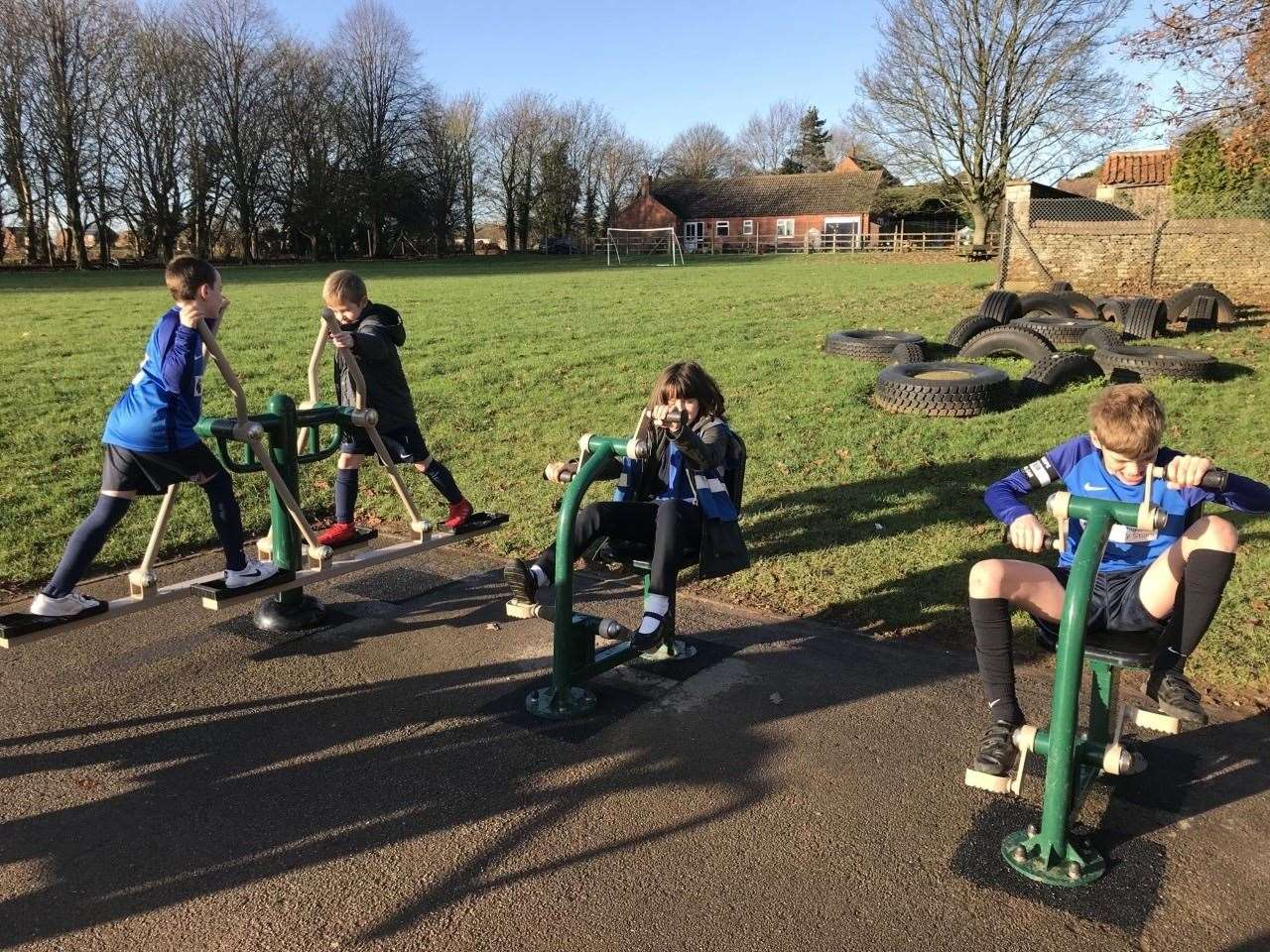 Noah Hutton, 10, Arion Woodward,11, and Ollie Harness, 11, enjoying Caythorpe Primary School's outdoor gym.