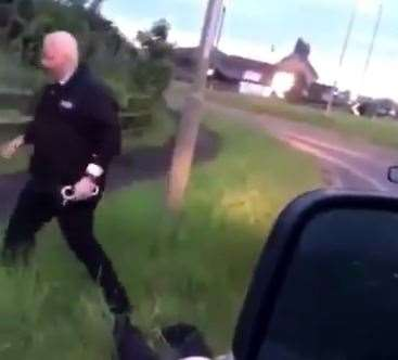 This shows the police officers pulling out his handcuffs before the video is interrupted.  (47672862)