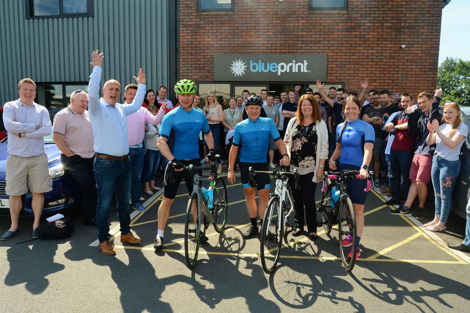 Blueprint Gaming managing director Simon Barff joins staff in waving off cyclists, left to right, Gavin Wright, Andy Hall and Nicola Wallbank, with Kate Baxter, a director of the Children's Bereavement Centre. 110618DC2-1