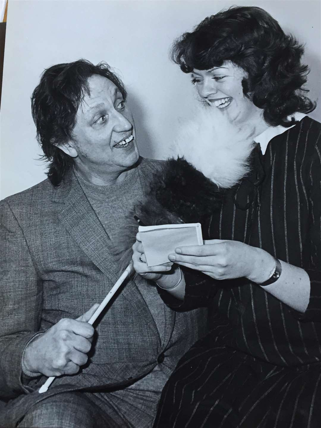 A YOUNG Lucy Millard interviews Ken Dodd at Newark's Palace Theatre, in the early days of her career.