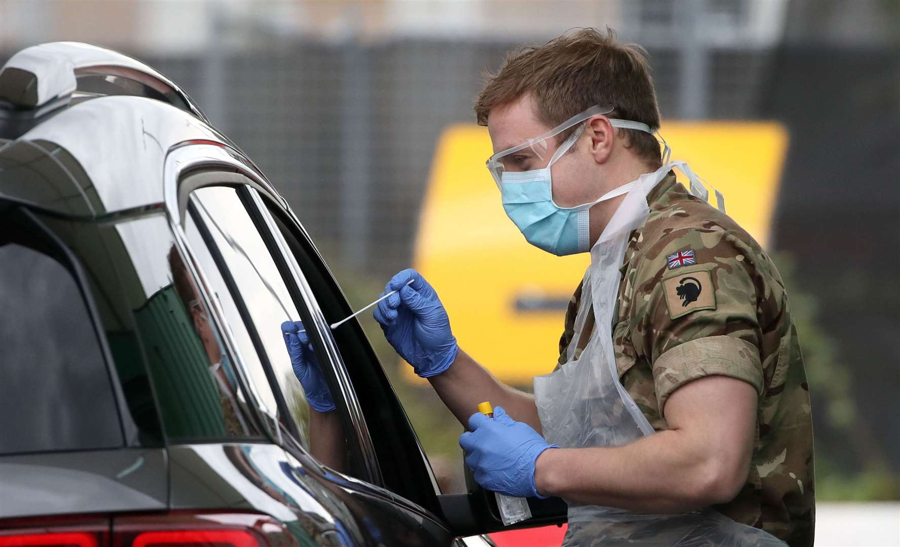 TESTING TIME: A member of the armed services carries out a swab to detect Covid-19