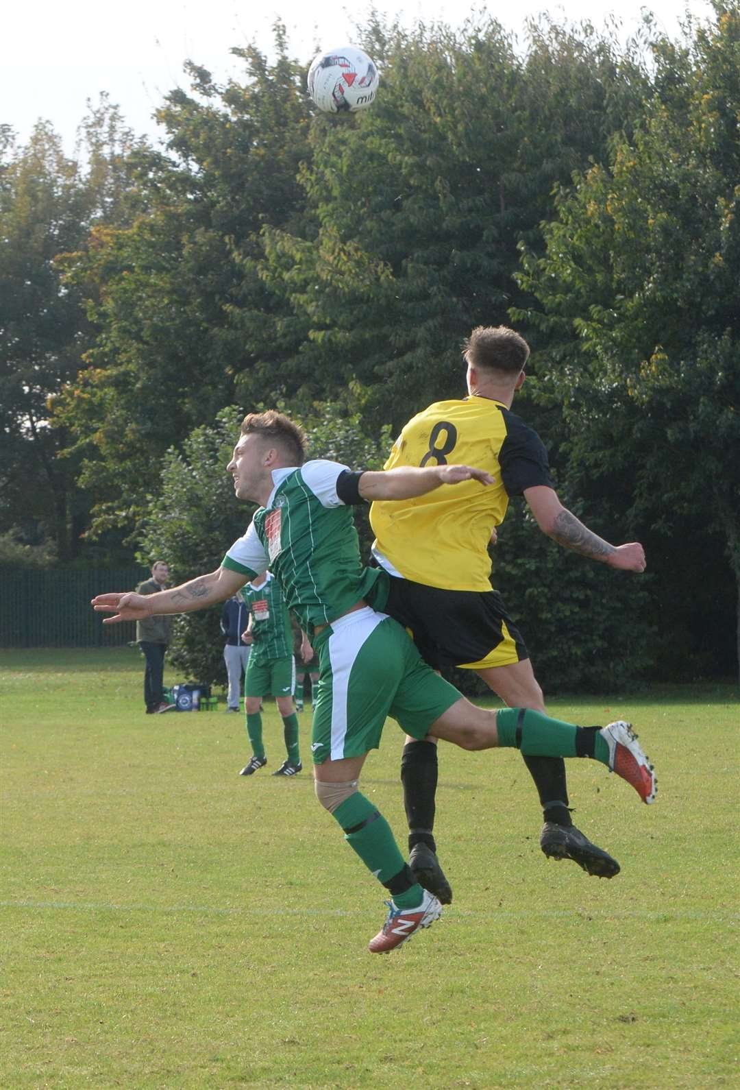 Adam Kettleborough in action for Holy Trinity (green and white). (4688161)