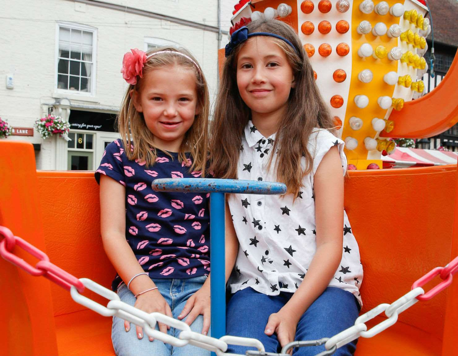 Eloise Neal, 7, left, and Ella Wilson, 9, on the funfair, which was part of Armed Forces Day in Newark for the first time. 250617LSP1-18