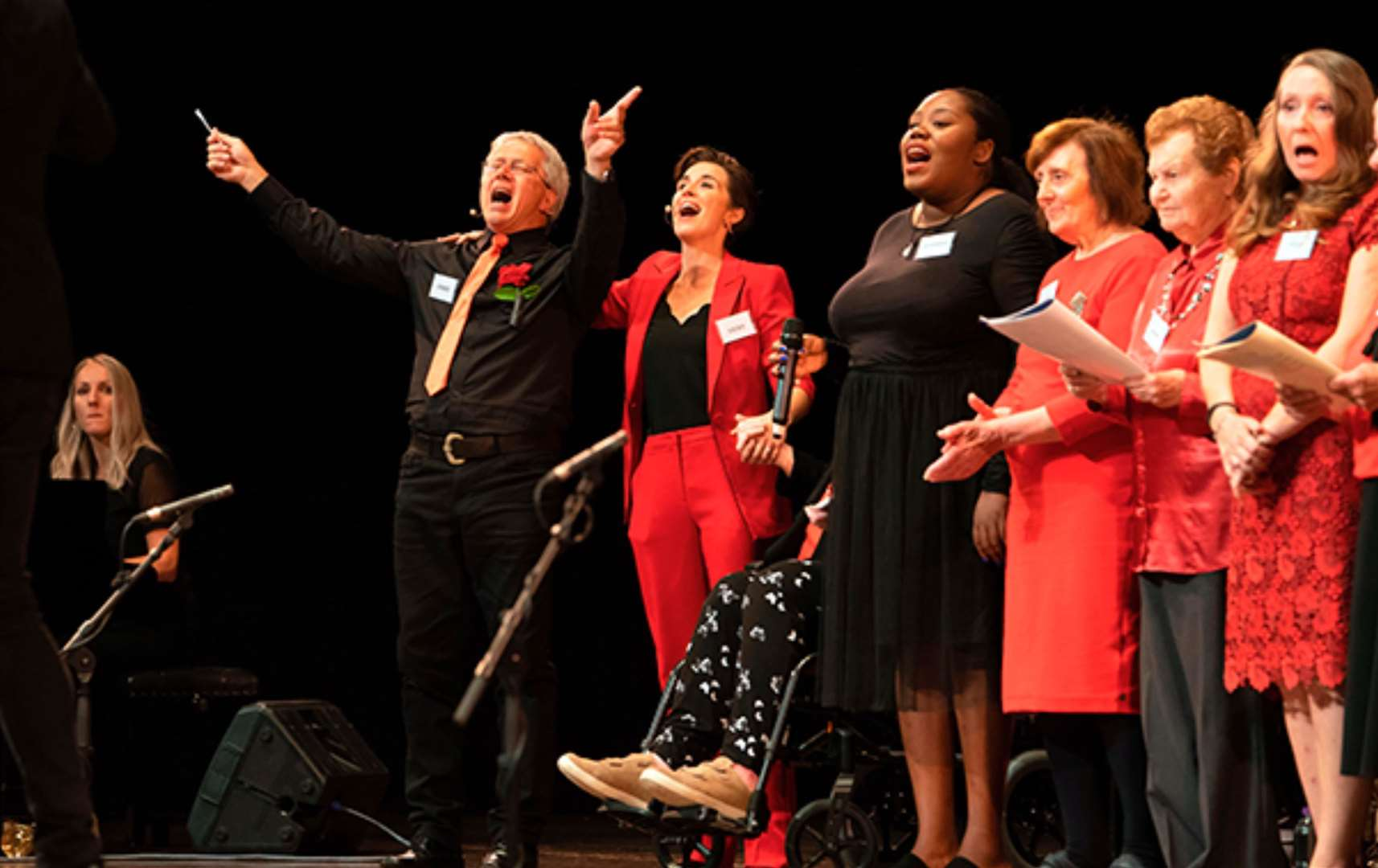 RETIRED teacher Chris Connell is pictured alongside Vicky McClure and other members of the dementia choir, performing on stage at the Royal Concert Hall, Nottingham.