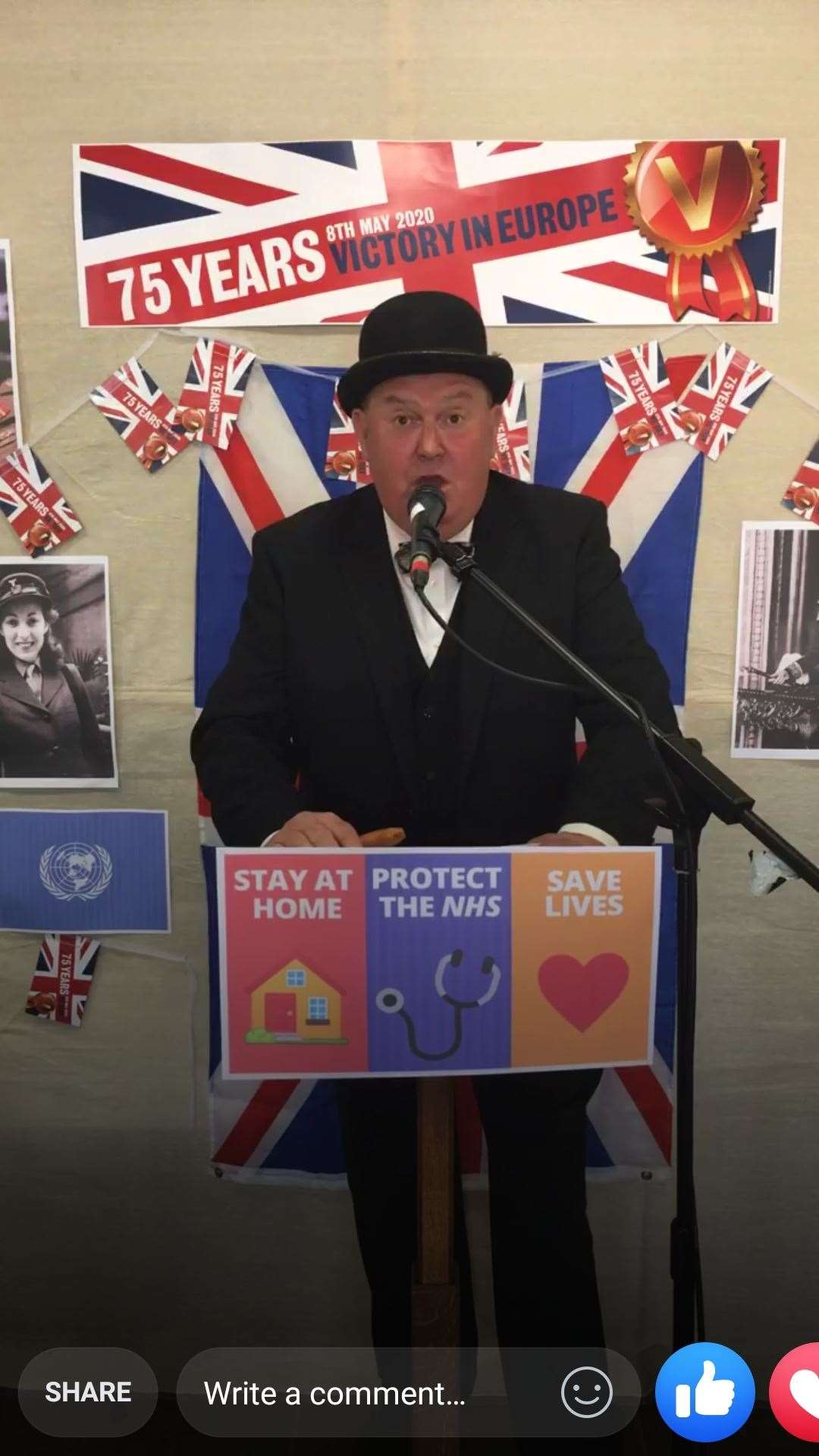 Will Gunn, dressed as Winston Churchill, addresses Orston on video as part of the village's VE Day celebrations. Credit: Orston Village on Facebook (36982479)