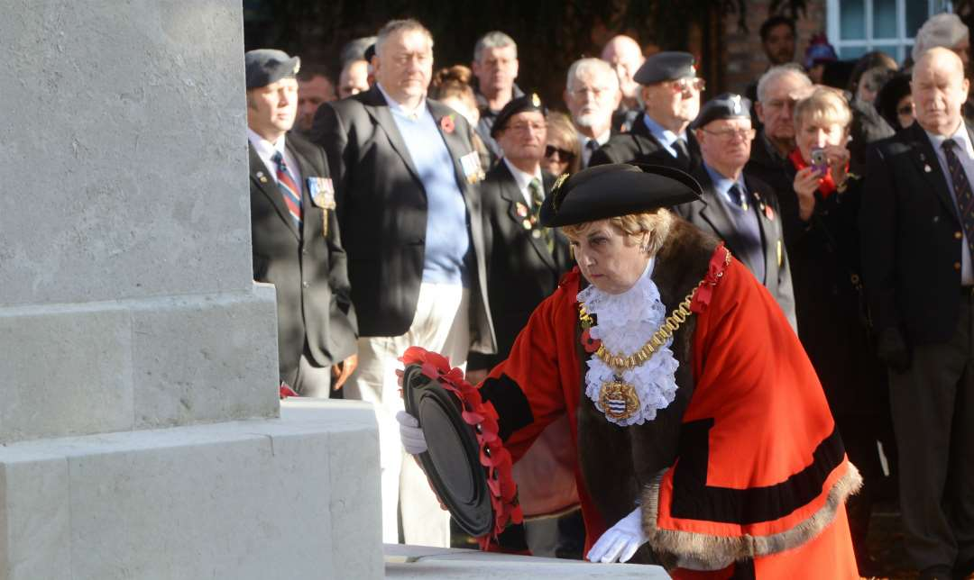 Rita Crowe, the Mayor of Newark, lays a wreath