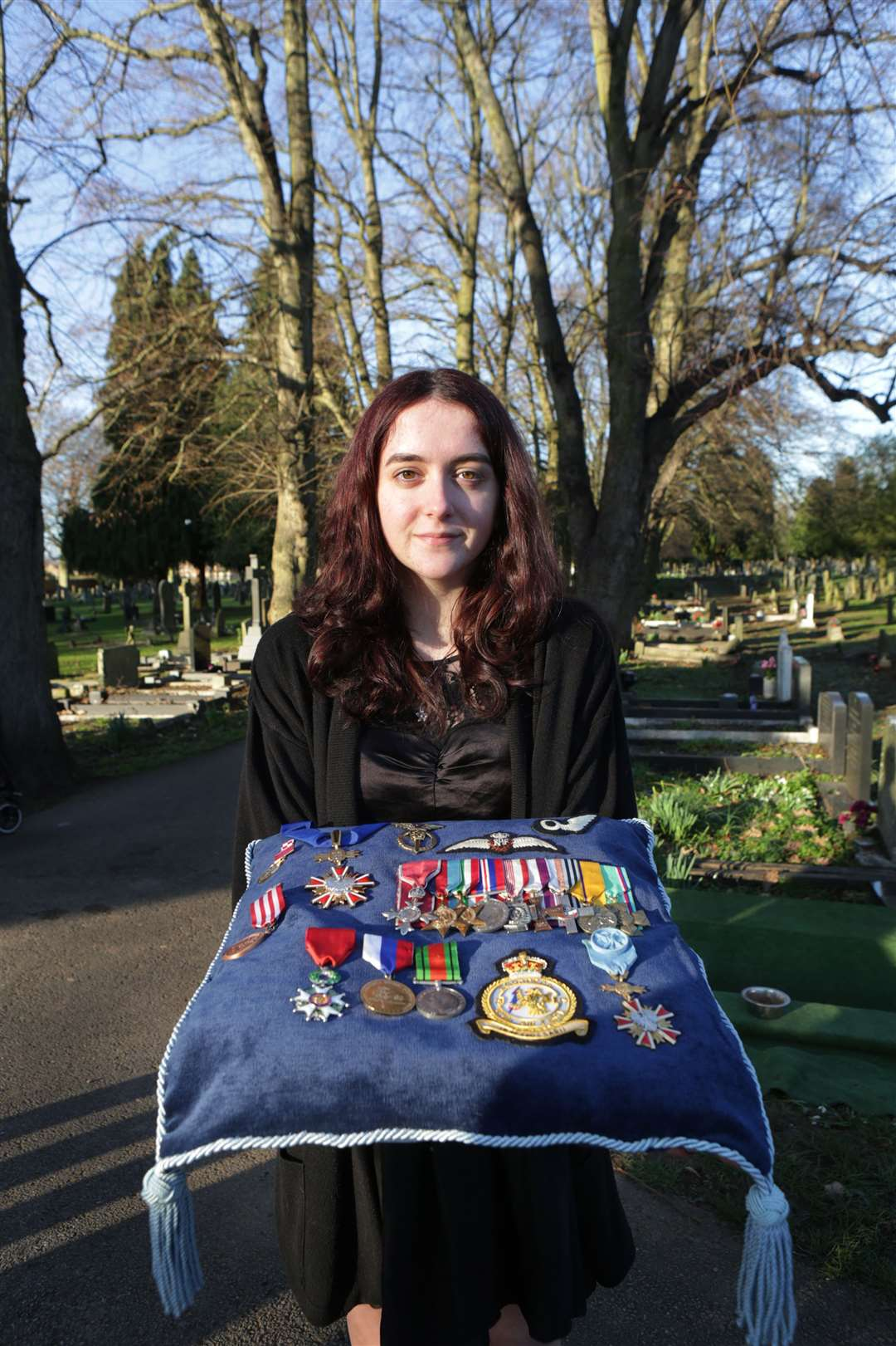 Katie Jeffery holds a collection of medals that belonged to RAF Bomb Aimer Jim Auton. 060220TV-15