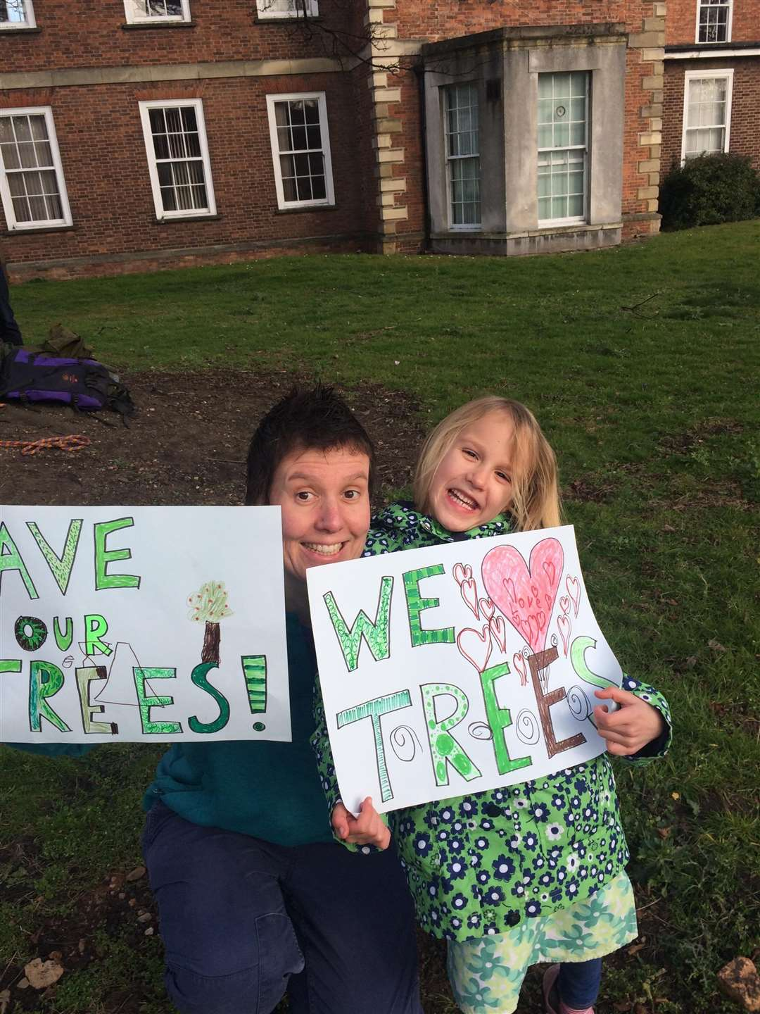 Adults and children gathered for a save our trees protest (7470447)