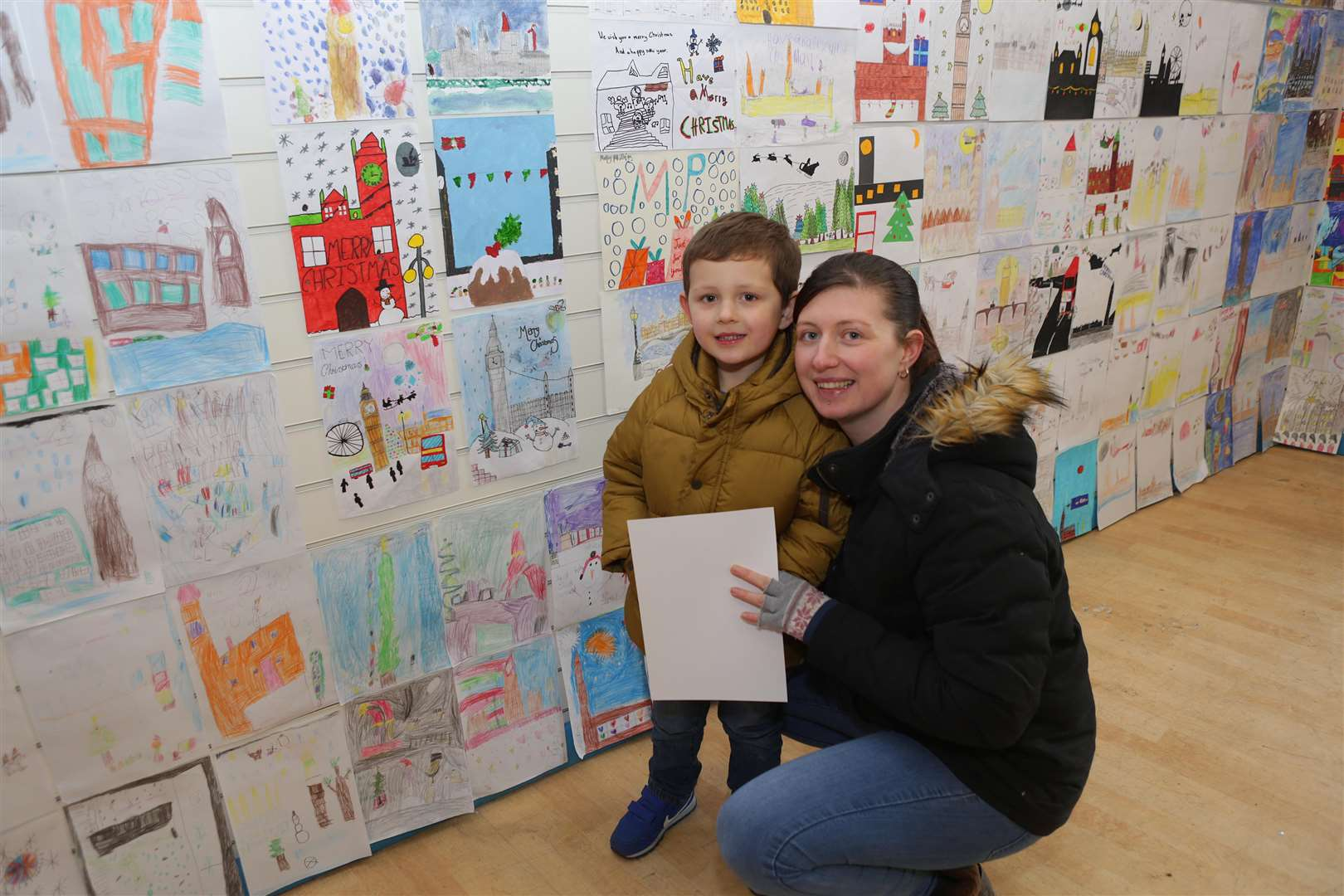 Newark Christmas Light Switch On 2018. Noah Griffiths, 4 and his mum Leanne Sabey of Newark, take a look at the entries into the Robert Jenrick Chrismas Card Design Competition on display at the YMCA.. (5609182)